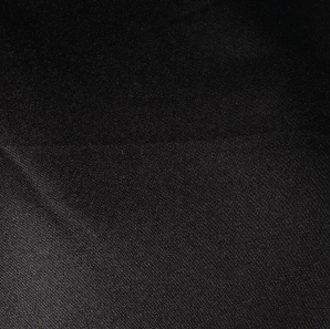 Close up of a black polyester tablecloth.