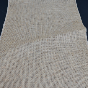 Close up of a burlap table runner.