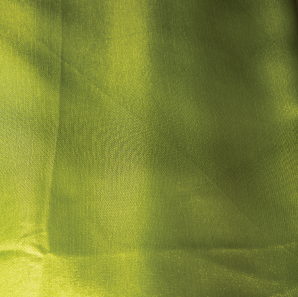 Close up of a lime green colored silk tablecloth.
