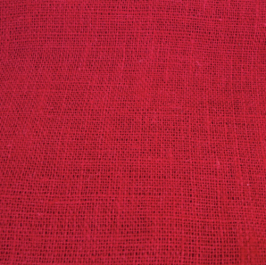 Close up of a red burlap table runner.