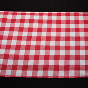 Close up of a red gingham check table runner.