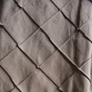 Close up of a silver pin tuck tablecloth.