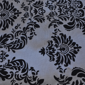 Close up of a black and silver patterned overlay.