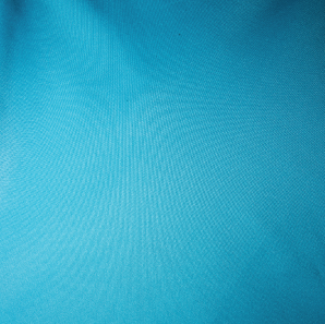 Close up of a turquoise colored polyester tablecloth.