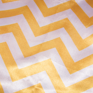 Close up of a yellow chevron patterned tablecloth.