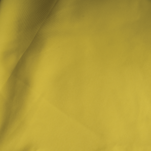 Close up of a yellow polyester tablecloth.